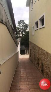 CORREDOR DE ACESSO AO QUINTAL  - Casa 4 Dormitórios